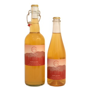 Botles of Pome Blend apple, pear, and quince cider in both 750 and 500 ml sizes