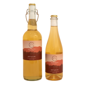 Bottles of Heritage Dry apple cider in both 750 and 500 ml sizes