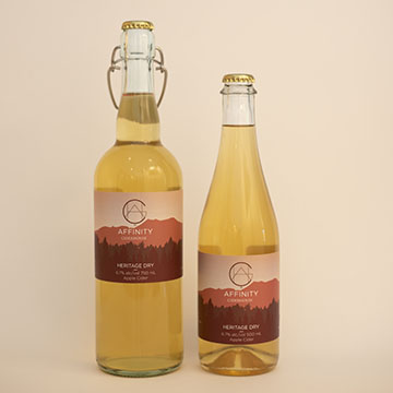Bottles of Heritage Dry apple cider in both 750 and 500 ml bottles