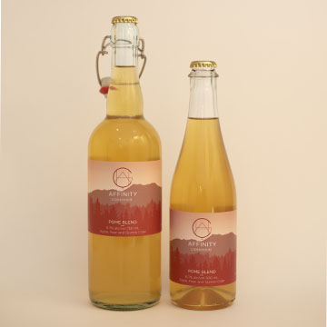 Bottles of Pome Blend apple, pear, and quince cider in both 750 and 500 ml sizes